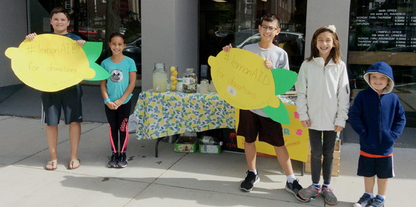 Kids holding lemonade signs